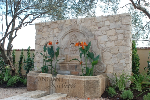 The legendary antique wall fountain, stone channel and coy pond combination, commissioned and realized by Ancient Surfaces, installed in Irvine California. Has been featured in many showcase home tours as well as on the front covers of national shelter magazines. www.AncientSurfaces.com
