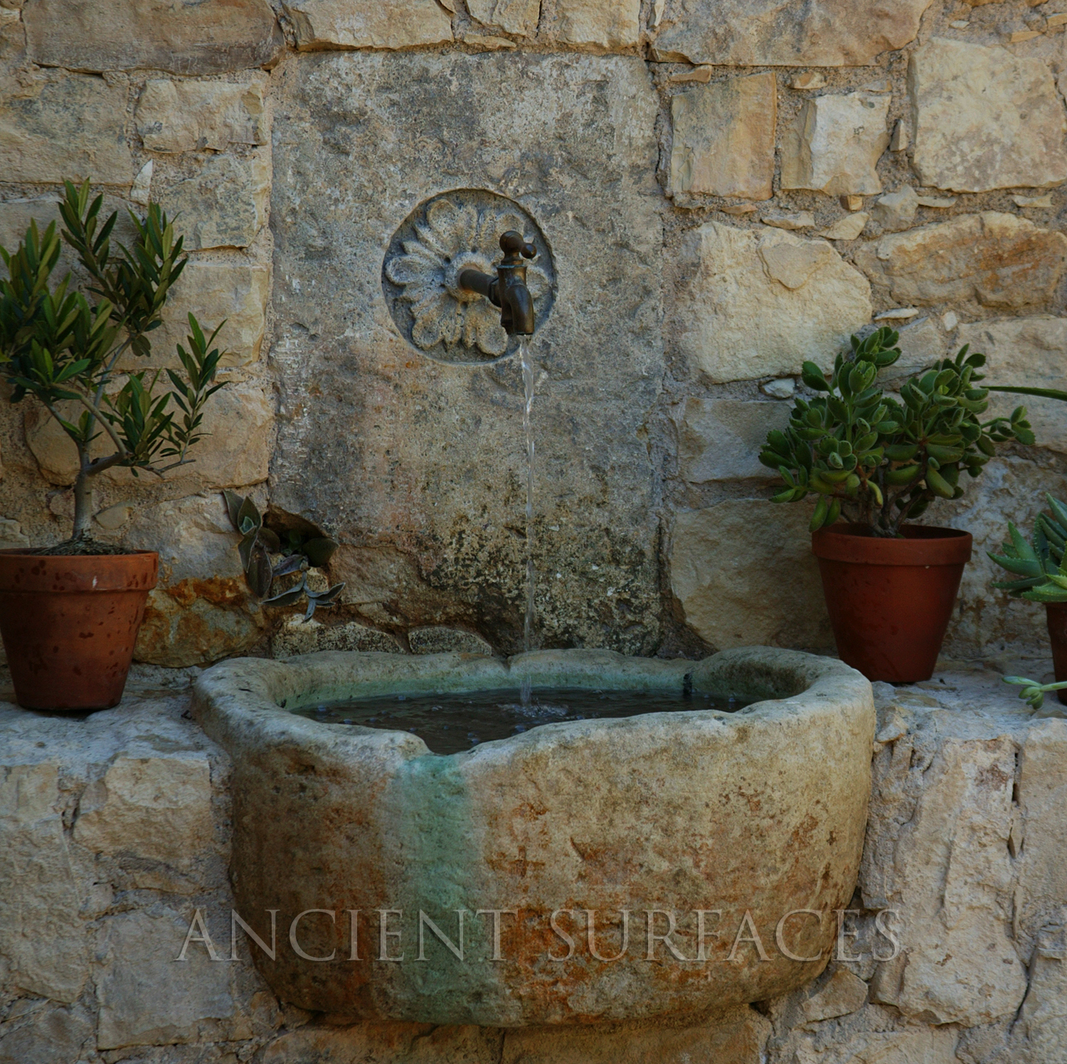 antique wall fountain with and reclaimed stone trough by ancient