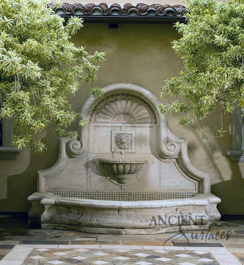Hand Carved Limestone Classical Wall Fountain in an Exposed Open Inside Courtyard By Ancient Surfaces.