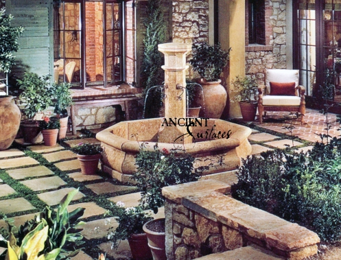 An Octagonal antique Limestone Pool Fountain By Ancient Surfaces in an Irvine California Home.