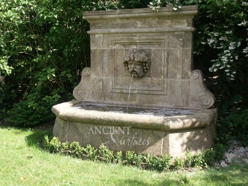 Antique Cherub head wall fountain by Ancient Surfaces.