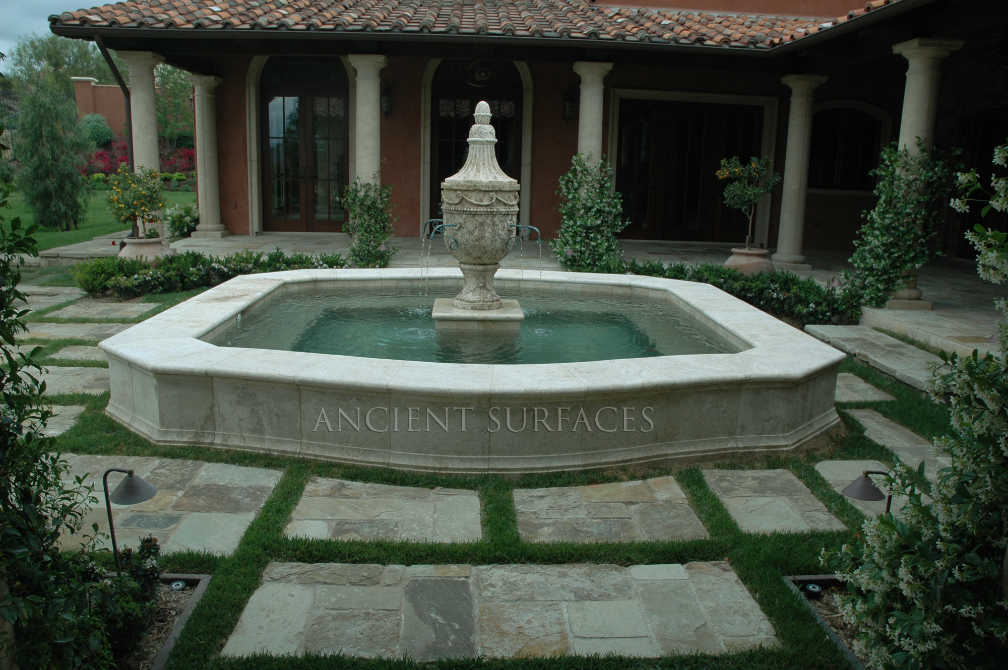 Provence style inclosed courtyard featuring antique stone for Garden pool fountains