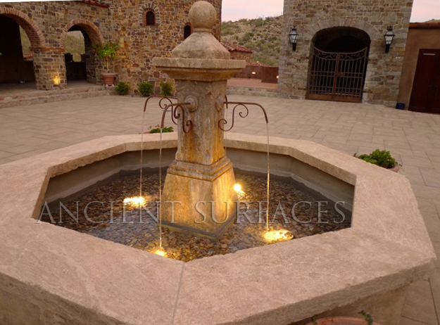 Antique Octagonal Stone Courtyard Fountain Featuring a Middle Carved Shaft that Dispenses Water. Pool lights were Included in the installation. Provided by Ancient Surfaces.